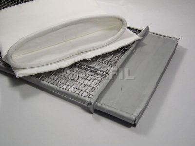 Envelope shaped filter bag with rubber ribbon holding, next to its wire cage.